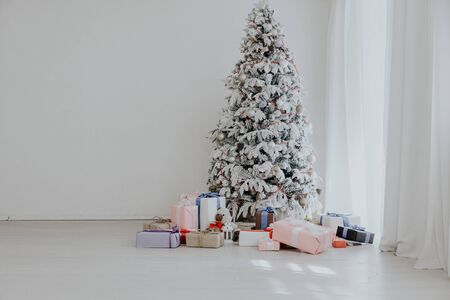 White Christmas tree in Konate with stocking-stuffers