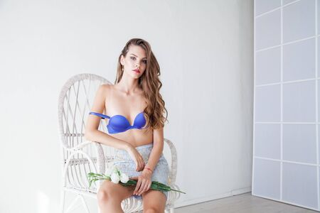 portrait of a beautiful fashionable woman in lingerie with a flower 版權商用圖片