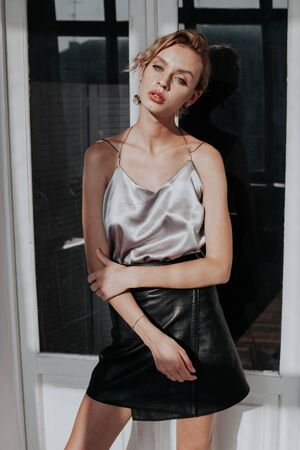 portrait of a beautiful fashionable blonde woman in a blouse and black skirt Stock fotó