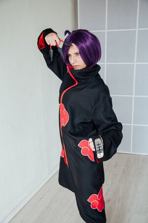 woman anime cosplayer with purple japan hair Stock Photo