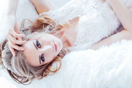 Portrait of a beautiful girl lying on a sofa 版權商用圖片