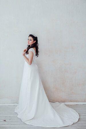 beautiful bride posing wedding hairstyle and dress