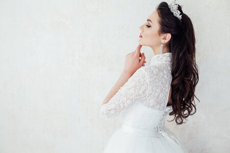 Portrait of a bride in a wedding dress and a Crown