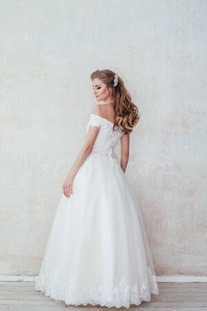 the bride at a wedding in white wedding dress