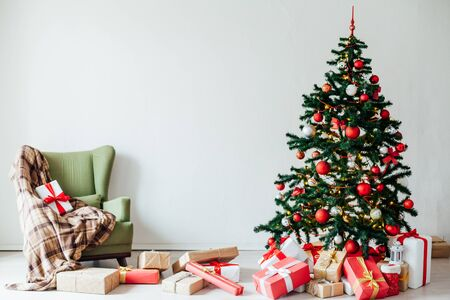 Christmas tree with gifts Of New Year's interior as a background