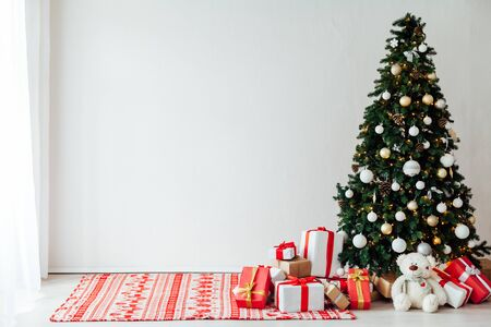 Christmas tree with gifts for the new year decor of the white room winter holiday