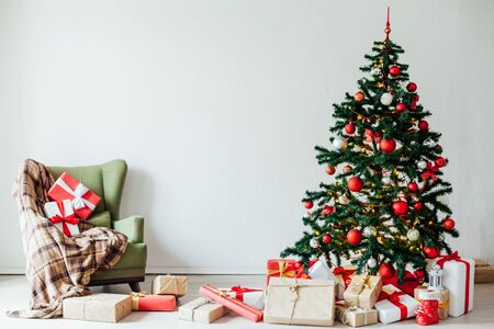 Christmas tree with red gifts decor home for new year postcard as background