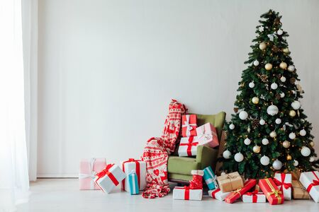 Christmas decor interior of the house Christmas tree with gifts for the new year as a background Stock Photo