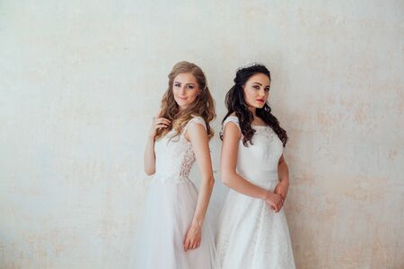 two brides in wedding dresses wedding blonde brunette