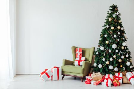 Christmas decor interior Christmas tree with gifts for the new year holiday postcard as a background
