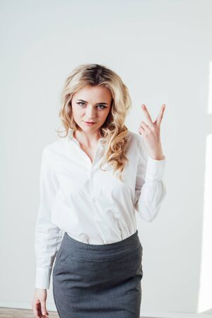 girl in a business suit shows characters hands