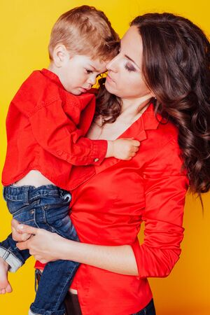 mother and son in red shirts family