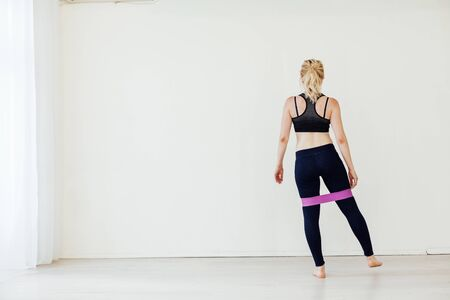 Blonde woman engaged in fitness with fitness gum Stock Photo