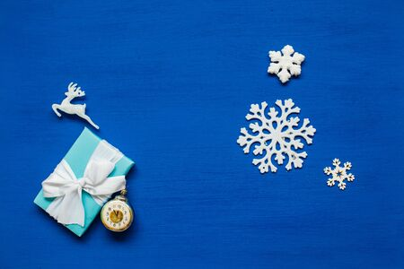 Christmas decor snowflake new year presents holiday blue background