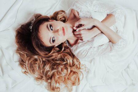 the bride in her wedding dress lay Stock fotó