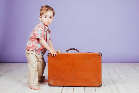 little boy going on a journey with suitcase