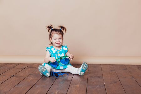 little girl plays with big glasses, she funny