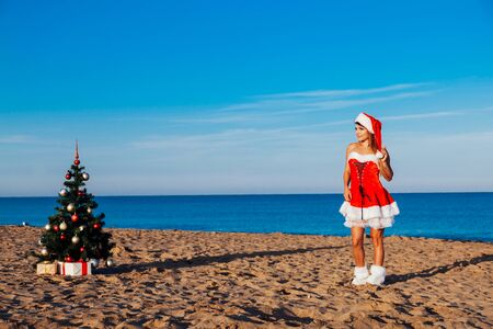 girl Christmasat a resort in the South by the sea