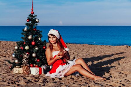 girl Christmas tree in the South on the beach