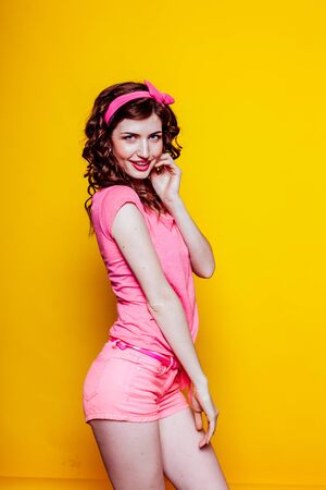 girl pinup style in a pink dress