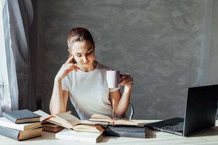 girl reading a book and drinking coffee