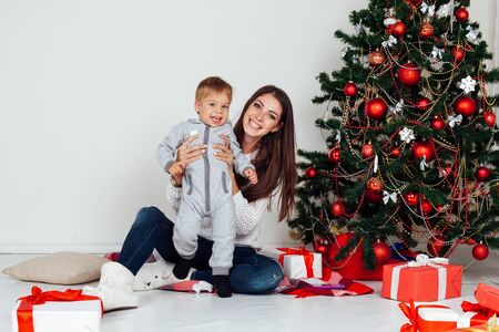 mother and son open gifts on Christmas and new year