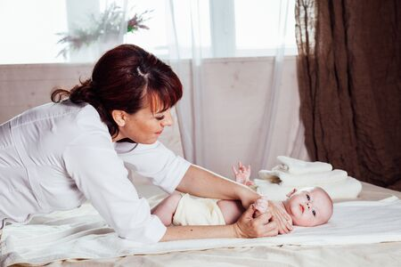 the little boy baby doctor doing massage