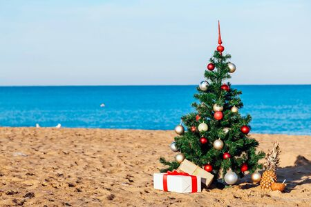 Christmas on the beach with gifts new year Archivio Fotografico
