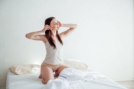 girl in lingerie woke up in the morning in the bedroom