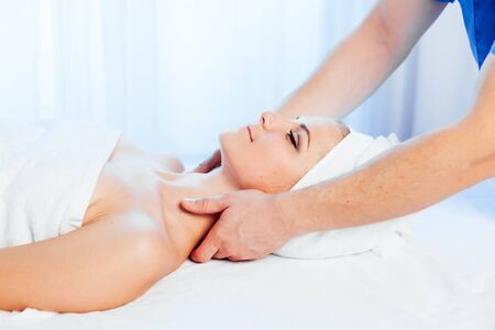 girl masseur doing massage in spa health
