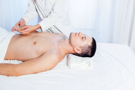male masseur doing Massage Spa health care 版權商用圖片 - 134881376