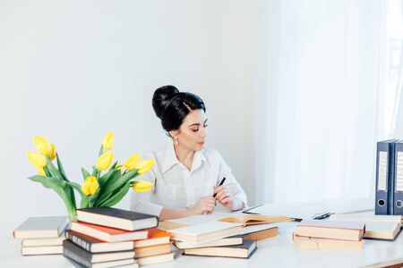 girl reading book at the table in the Office business 版權商用圖片