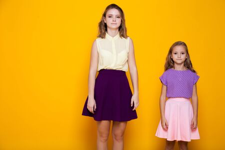 Portrait of two fashionable beautiful girls in dresses 版權商用圖片 - 134881306