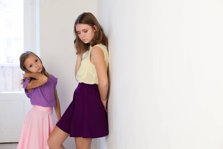 Portrait of two fashionable beautiful girls in dresses