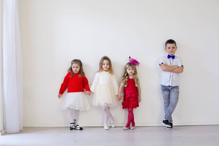 Boy and girls friends on red white birthday party