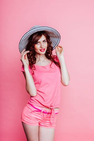 the girl in the hat on a pink background pinup 写真素材