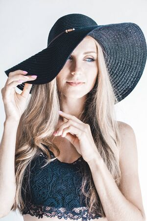 beautiful girl in a hat with a brim fashion 写真素材