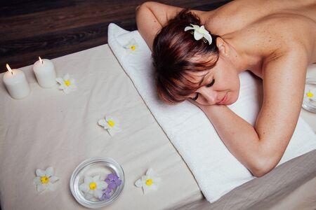 the beautiful girl lying in Spa massage sauna