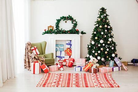 Christmas tree with gifts in the new year decor interior