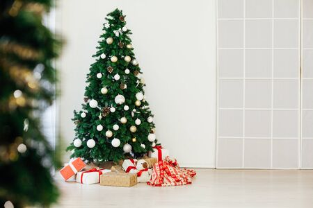 Christmas tree with gifts new year interior decor as background