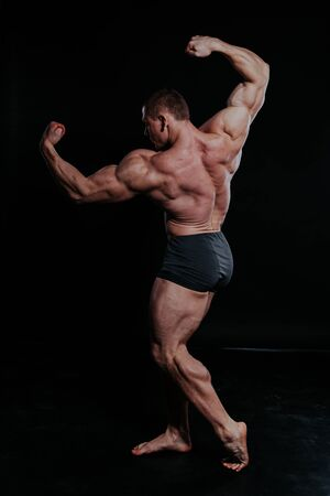 the athlete bodybuilder shows his muscles after sports Фото со стока
