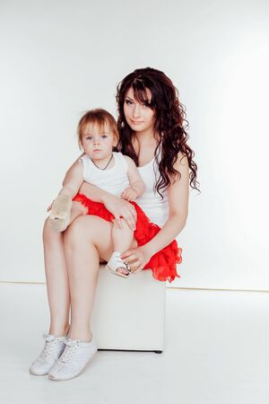 mother and little daughter in red skirts