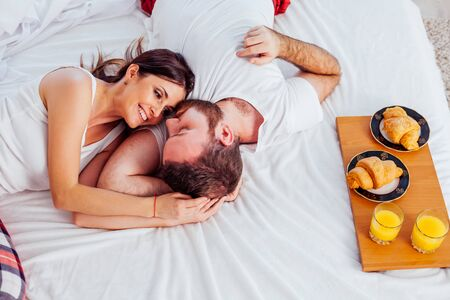 man and woman breakfast in bed morning Stock Photo - 137365526