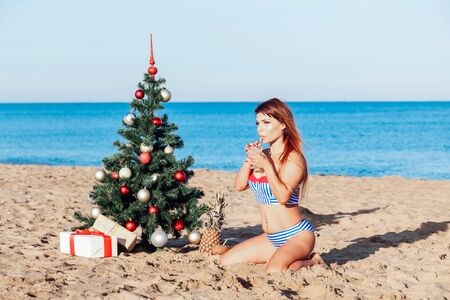 girl on Christmas vacation on a beach resort