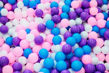 Un montón de bolas multicolores ronda textura de fondo Foto de archivo