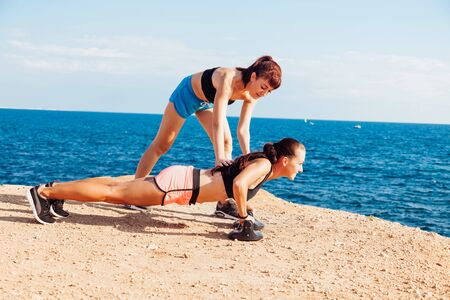 woman goes in for Sports Fitness on the beach