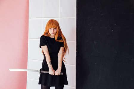 woman anime with red hair with Japanese samurai sword Stok Fotoğraf