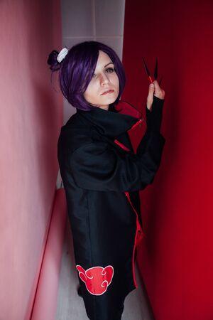 woman anime with purple hair in black dress Japan Stockfoto