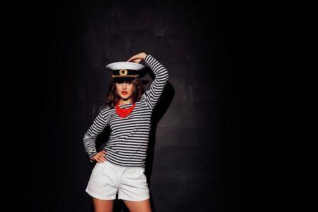 a girl in a cap style fashion pinup Reklamní fotografie