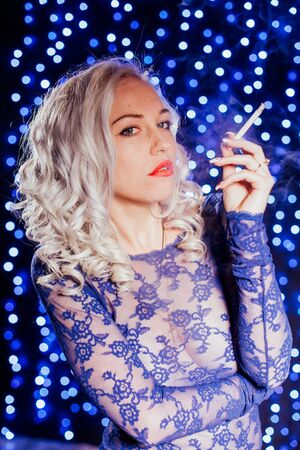 sexy blonde in blue lingerie red lips smokes